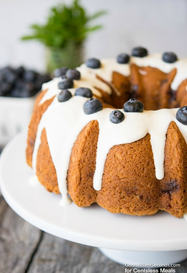 Blueberry Coffee Cake glazed and garnished with fresh blueberries.