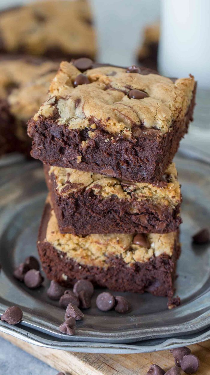 Three brookies bars on a plate with chocolate chips