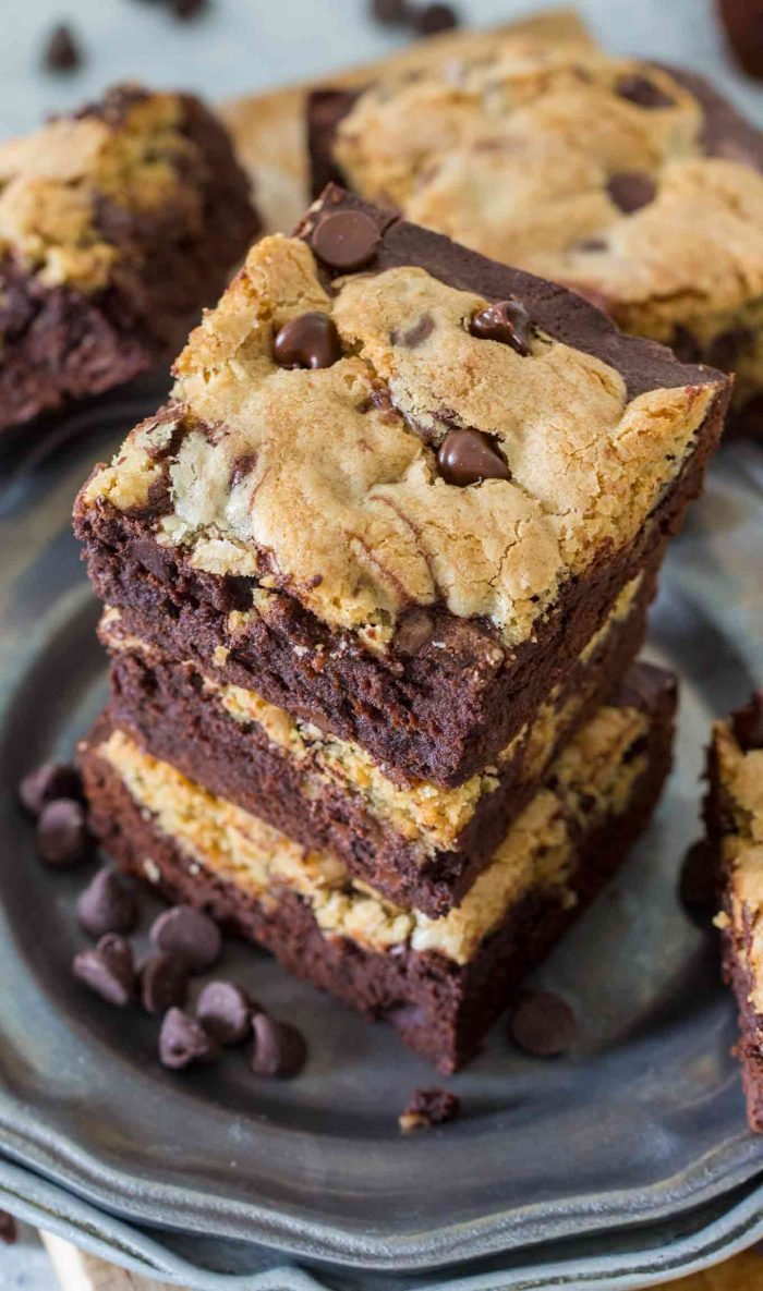 Brookies bars stacked up on a plate with chocolate chips