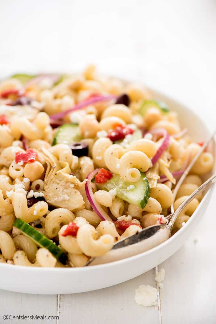 Mediterranean Pasta Salad served in a small white bowl