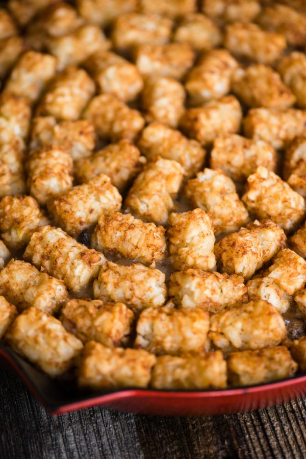 Tater Tot Hotdish prepared in a skillet