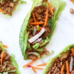 Chicken lettuce wraps with radishes green onions and carrots