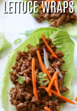 Chicken lettuce wrap with carrots and onions and writing