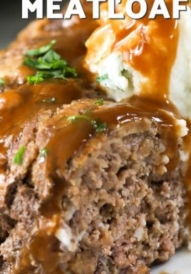 Stove top meatloaf on a plate with gravy and a title
