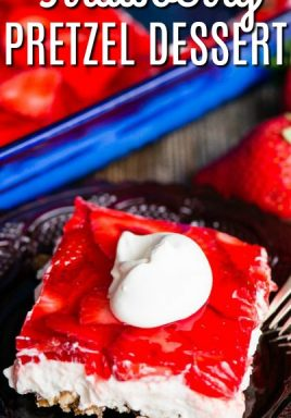 Strawberry pretzel dessert on a plate topped with whipped cream and a title