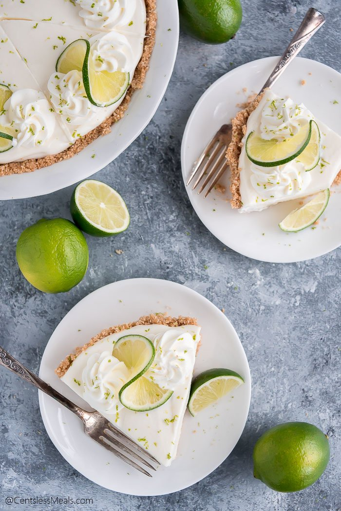 Two plates with pieces of Key Lime Pie and forks