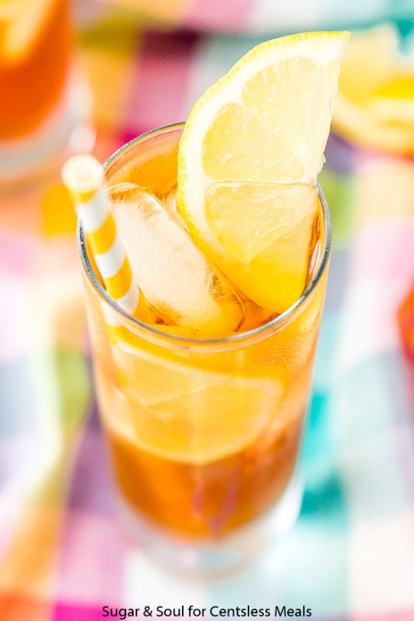 Vodka Sweet Tea in a tall glass garnished with a lemon wedge