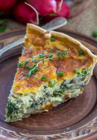 Spinach Quiche Recipe that is buttery, creamy and can be loaded with your favorite veggies. Makes for a delicious make ahead breakfast and is perfect for brunch!