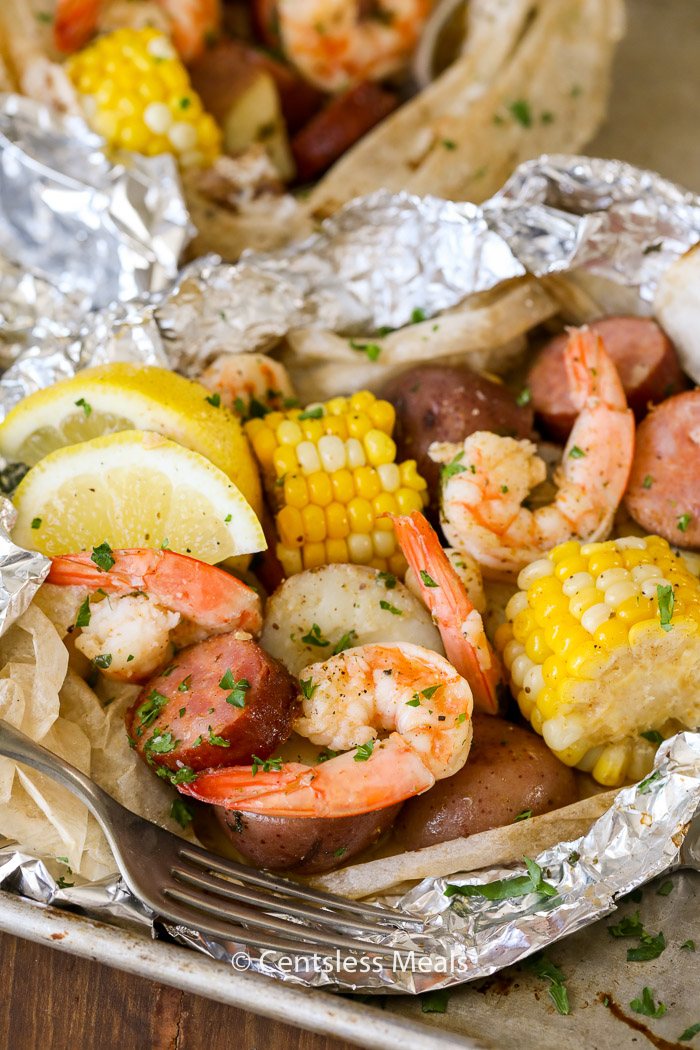 Shrimp boil foil packets with parsley and a fork