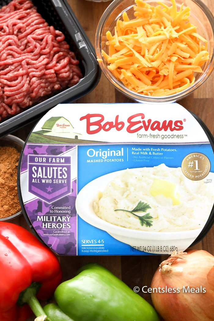 Bob Evans mashed potatoes and other ingredients for taco shepherd's pie on a wooden board