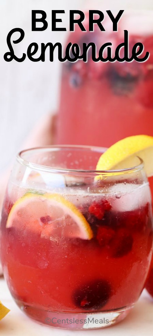 A glass of Sparkling Berry Lemonade garnished with lemon wedges.
