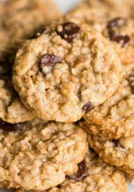 Oatmeal chocolate chip cookies on a plate with a title