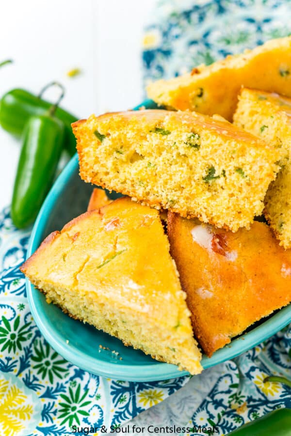 Jalapeño Cornbread wedges served in a blue serving dish