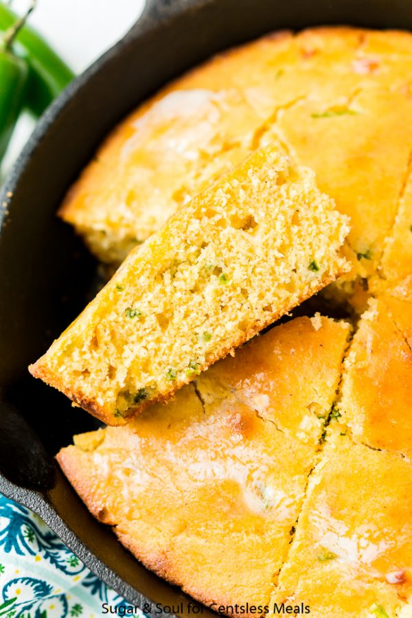 Wedges of Jalapeño Cornbread cut out of a skillet
