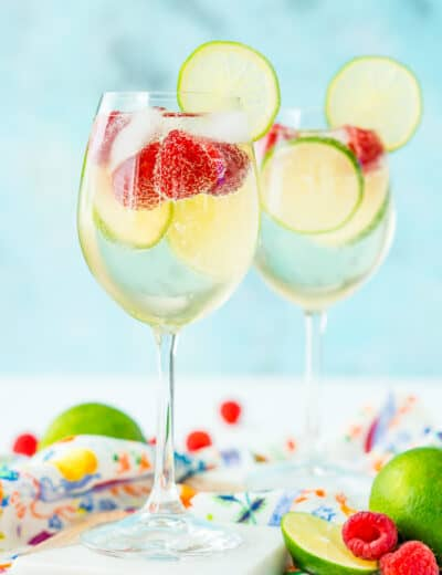 Wine glasses filled with raspberry lime wine spritzer