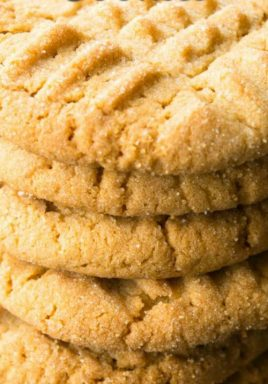 Stack of peanut butter cookies with a title