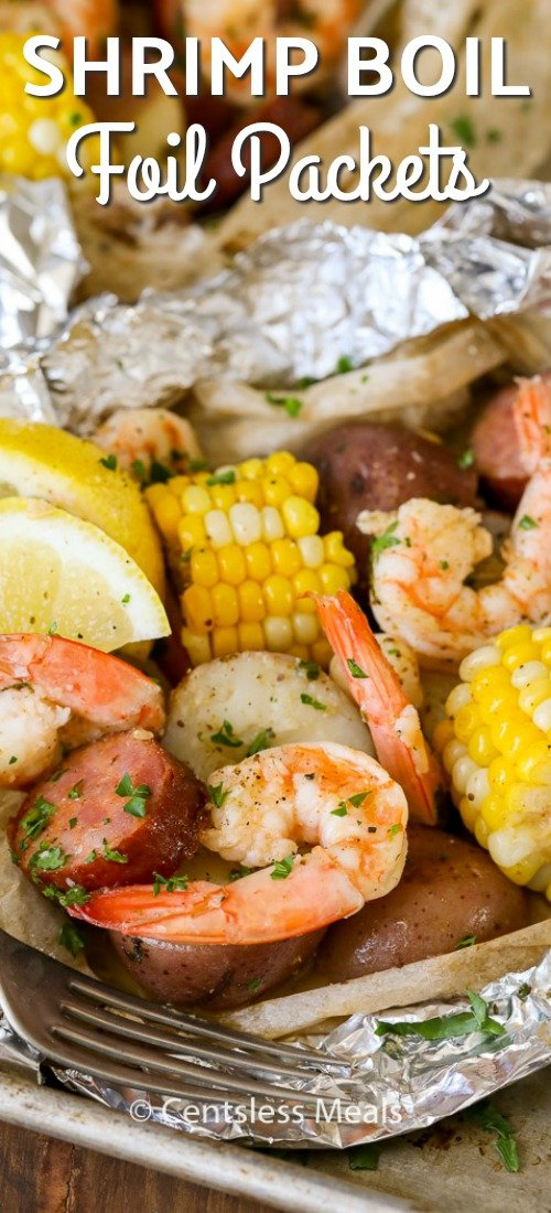 Shrimp Boil Foil Packs take all of the fun of a shrimp boil and turn them into perfectly portioned individual packs! Juicy shrimp, tender potatoes, corn, sausage, and of course butter are grilled in a foil pack to give you a fun dinner option that everyone will love! #centslessmeals #shrimpboil #foilpackets #easyrecipe #simpledinner #withpotaotes #withcorn
