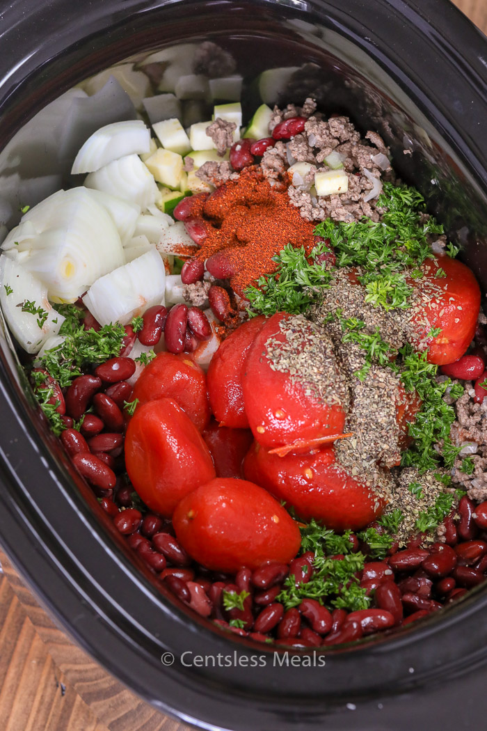Ingredients for Slow Cooker Chili in the bottom of a slow cooker