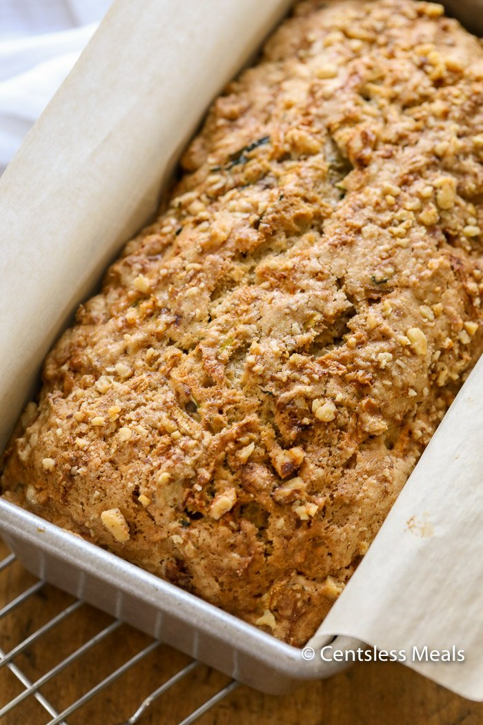 Zucchini bread in a loaf pan with parchment paper