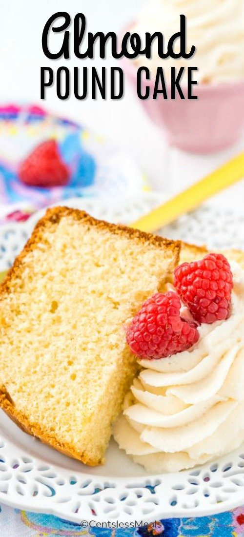 Almond Pound Cake served on a white plate and garnished with raspberries