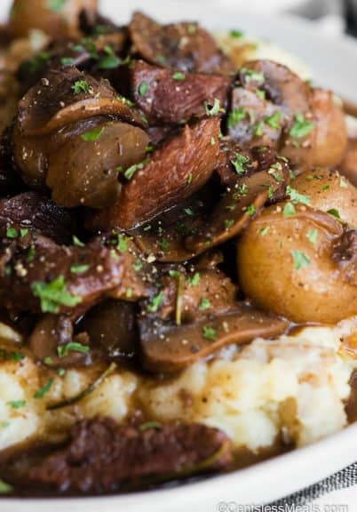 beef and mushrooms in gravy over mashed potatoes