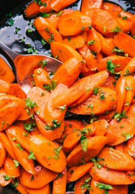 Candied carrots with a spoon and parsley