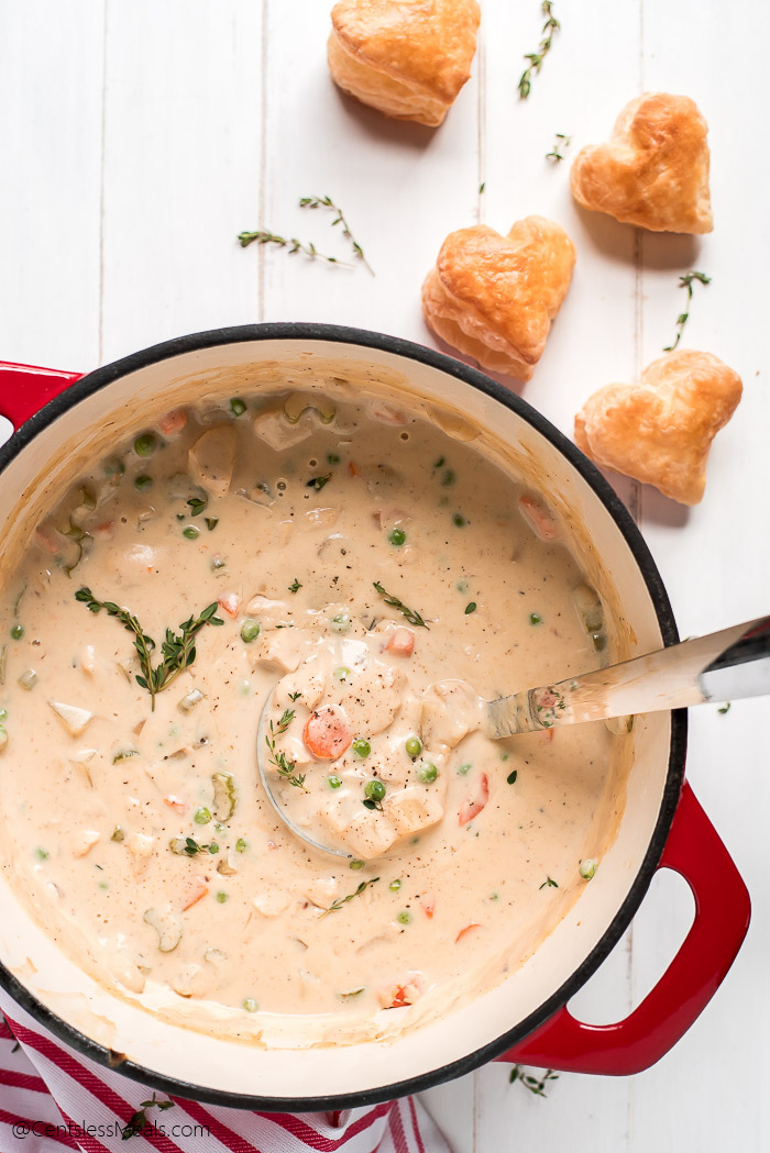 A pot of Chicken Pot Pie Soup with puff pastry hearts on the side.