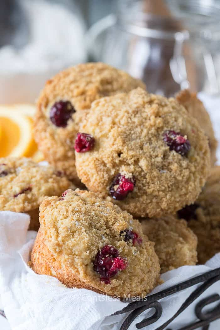 A basket full of fresh cranberry orange muffins.