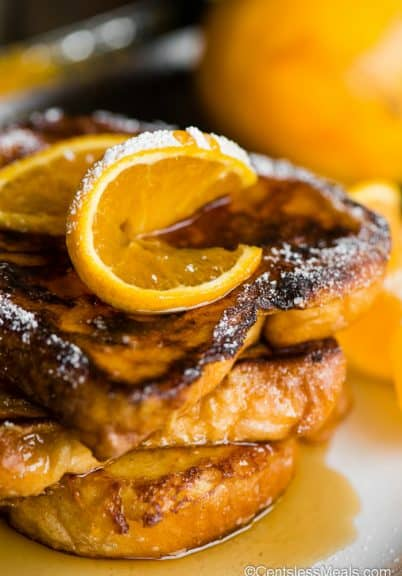 stack of french toast with orange