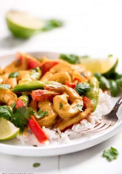 Shrimp Curry on a plate with rice and a fork