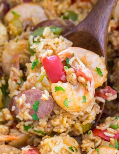 Jambalaya Recipe in a blue pot with a wooden spoon