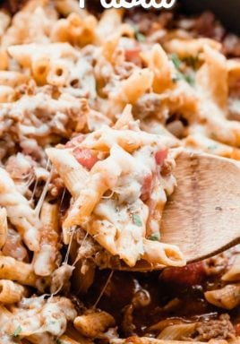 Italian Sausage Pasta has pasta and sausage all tossed with a rich tomato sauce and topped with mozzarella and parmesan cheeses. It goes from the stove, to the oven, to your plate in less than 30 minutes! #centlessmeals #onepotmeals #italiansausagepasta #sausagerecipes #30minutemeals #familyfriendly #easypastarecipe