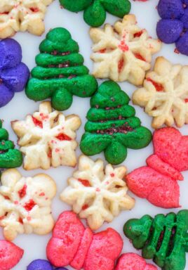 Spritz Cookies are fun to make, look festive, and taste delicious. They are perfect for the holiday season, and can be made in various colors and shapes.