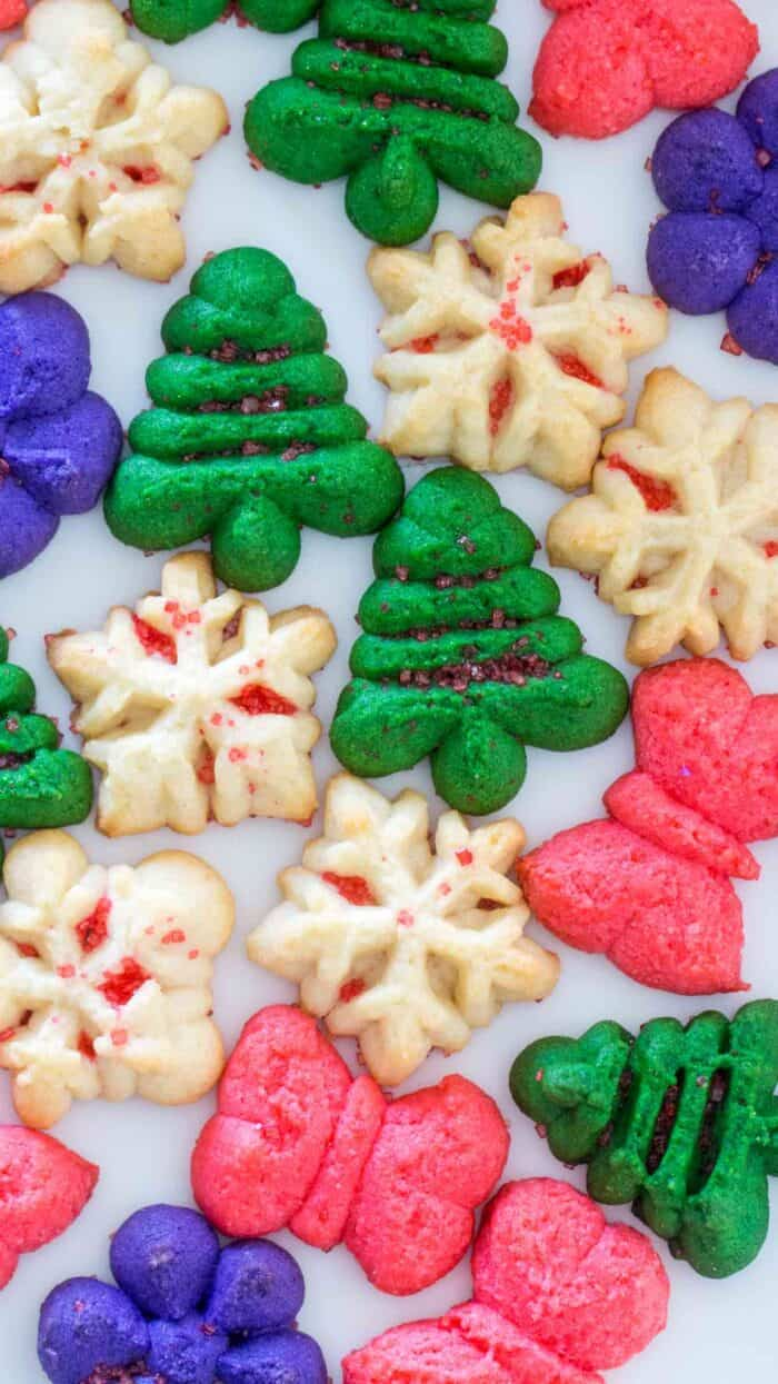 Spritz Cookies, in various colors, on a baking sheet