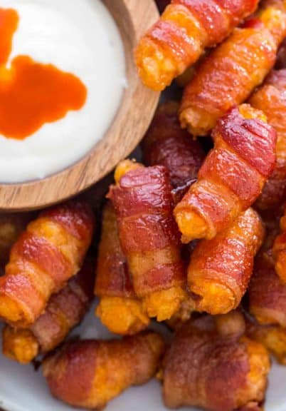 Bacon Wrapped Tater Tots make the perfect finger food. Such an easy, perfect bite size appetizer, that can be put together with minimum effort and fairly quickly.