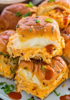 Buffalo Chicken Sliders made with rotisserie chicken, provolone cheese and buffalo sauce, are perfect for hosting an event, or to entertain a larger crowd.