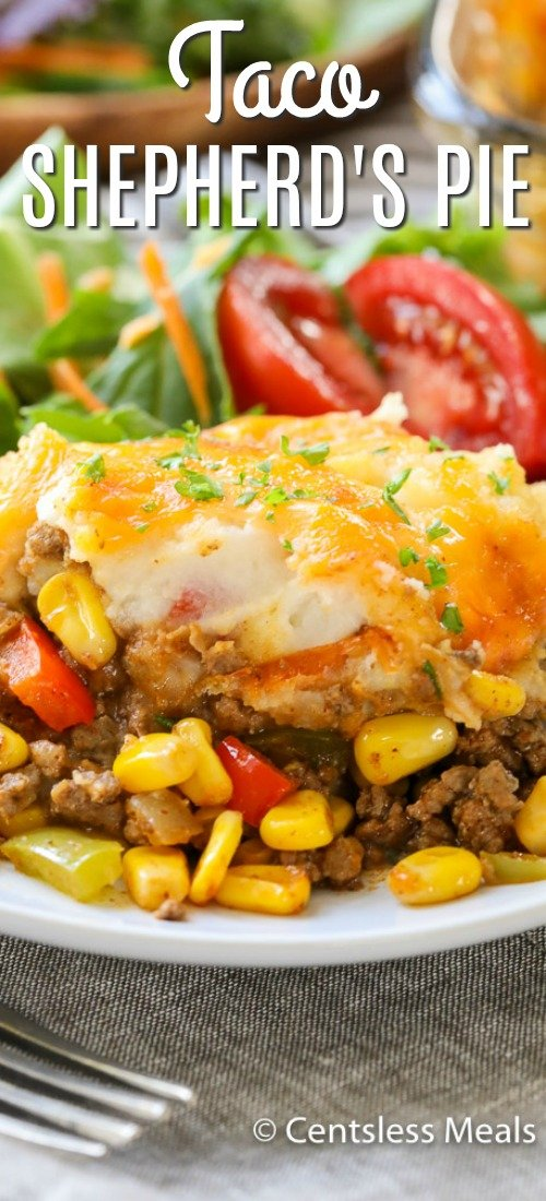 Taco Shepherd's Pie is a delicious mixture of taco meat, corn, and peas are topped with buttery mashed potatoes and cheese, then baked to golden perfection. #centslessmeals #shepherdspie #easyrecipe #casserole #comfortfood #easydinner #weeknightmeal #mashedpotatoes #easycasserole #maincourse #baked #withcheese