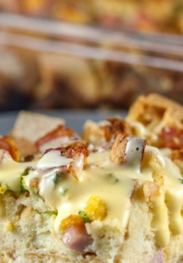 Eggs benedict casserole on a plate with a title