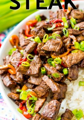 Pepper steak in a bowl with rice and a title