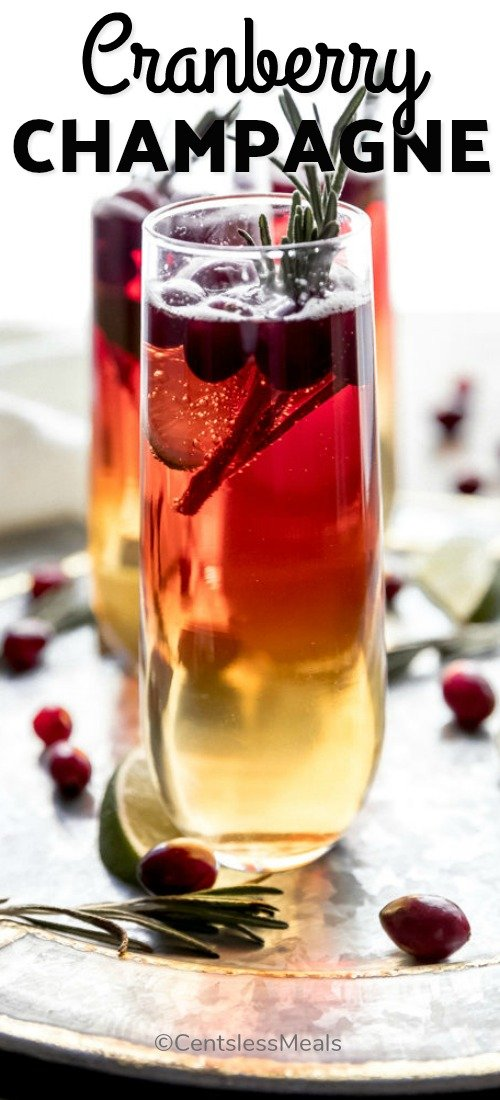 Cranberry champagne cocktail in a glass with a title