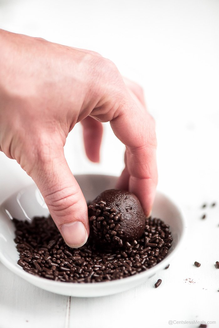Dipping and rolling a Chocolate Truffle in chocolate sprinkles