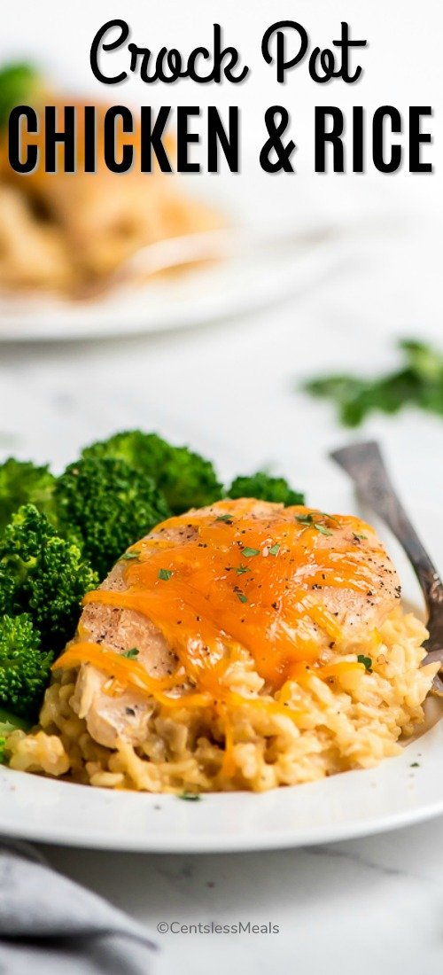 This delicious Crock Pot Cheesy Chicken and Rice served on a white plate with a side of broccoli