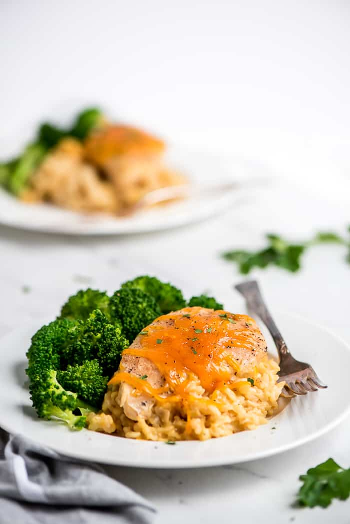 Crock Pot Cheesy Chicken & Rice on a plate with broccoli.