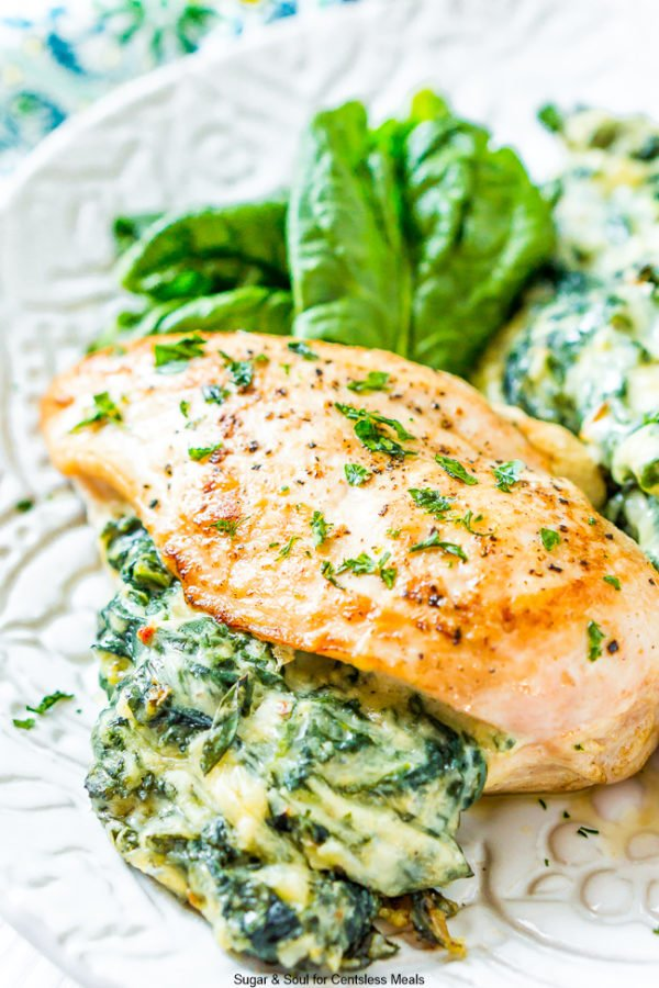 The filling from Spinach Stuffed Chicken is spilling out of one piece of chicken