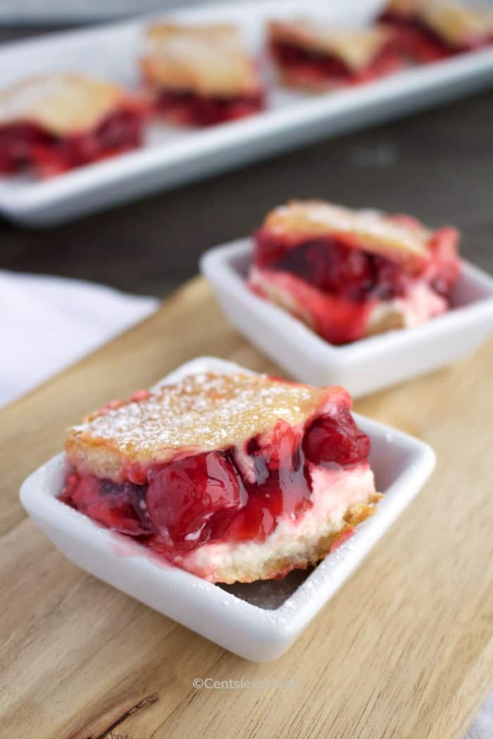 Cherry Cream Cheese Bars served in small white square dishes