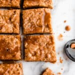 Squares of butterscotch Blondie's on a marble board
