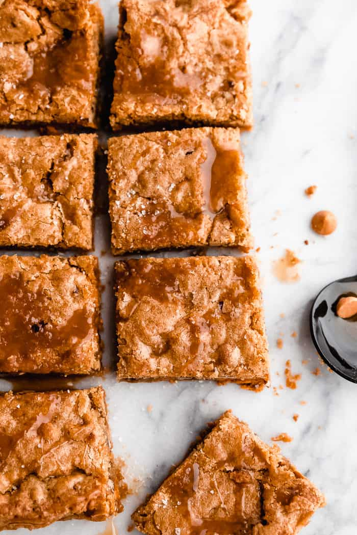 Butterscotch Blondies cut into squares resting on a marble countertop
