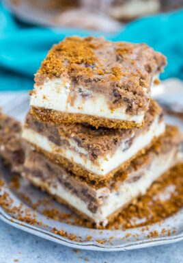 Stack of pecan pie cheesecake squares on a plate