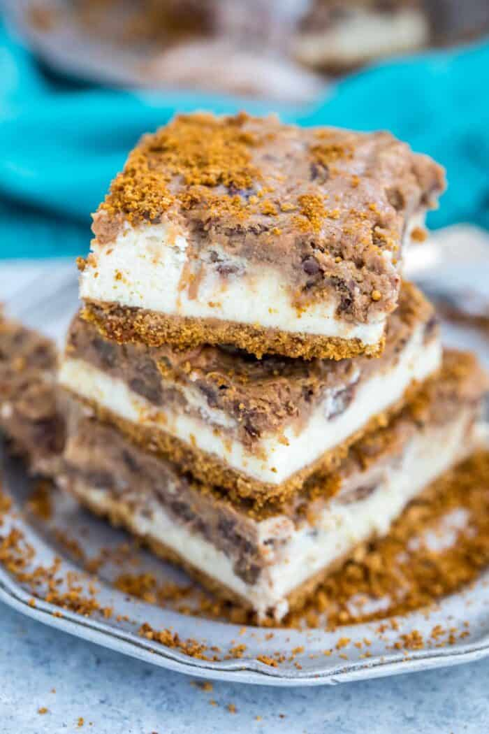 A stack of Pecan Pie Cheesecake Bars on a silver plate