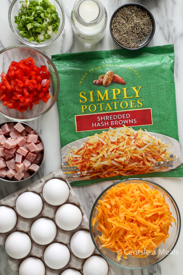 Ingredients for Simply Potatoes hash brown breakfast casserole on a marble board